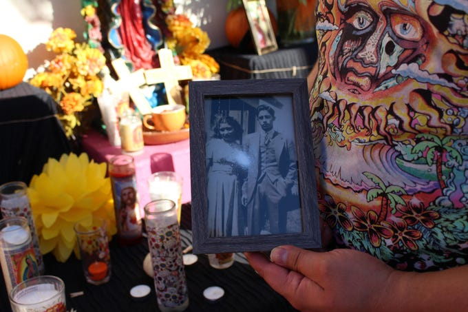 ET Rivera, owner of Tres Leches Cafe in Phoenix, shows a photo of his grandparents on Oct. 17, 2019.