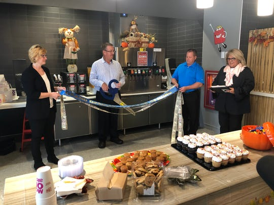 Sarah Davidson-Nelson, Markus Schulz, Brian O'Hare and Thelma Castillo participate in a ribbon cutting ceremony at the new St. Clair Township McDonald's location on Oct. 17, 2019.