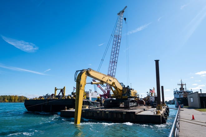 Barges are moored on the St. Clair River near Pine Grove Park where crews are working to complete a $155,321 project to shore up the infrastructure supporting two 36-inch water intake pipes at the city's water filtration plant.