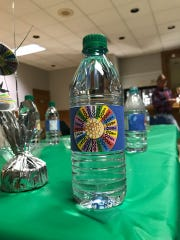 """""""Wheel of Fortune"""" water bottle decorations at a watch party hosted by Emily Leach."""