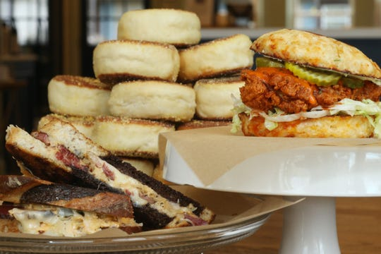 From left, The Dixie Kiefer Reuben, house made english muffins and the Nashville Hot Chicken from The Beacon Daily on October 17, 2019.