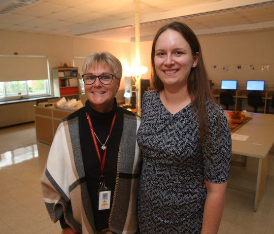 From left, Arlington High School computer science teacher Dawn Orlick and 2005 graduate Becky Howard-Pon, at Arlington High School on October 16, 2019.