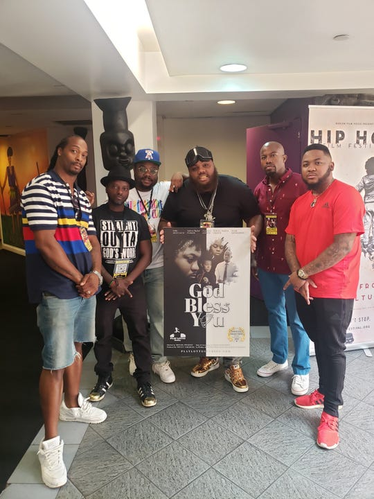 "From left, RH Bless, Michael Pinkney, Elijah DonMartin, Josiah DonMartin , Guyviaud Joseph, and Julito McCullum pose with a ""God Bless You"" poster. The award-winning short film was crafted by the DonMartin brothers, formerly of York."