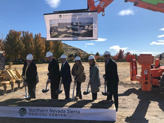 Northern Nevada Health Systems executives and local officials pose for a photo during the ground breaking for the new Northern Nevada Sierra Medical Center hospital in south Reno.