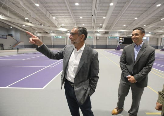 Daan Braveman, President of Nazareth College, left, and Gabe Antenucci, Higher Education Studio Manager at LaBella Associates, give a tour of the facility.