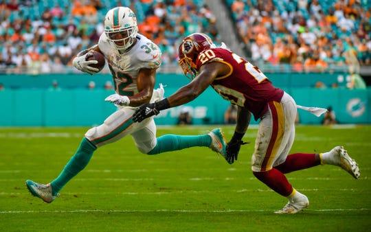 Miami Dolphins running back Kenyan Drake (32) carries the ball as Washington Redskins strong safety Landon Collins (20).