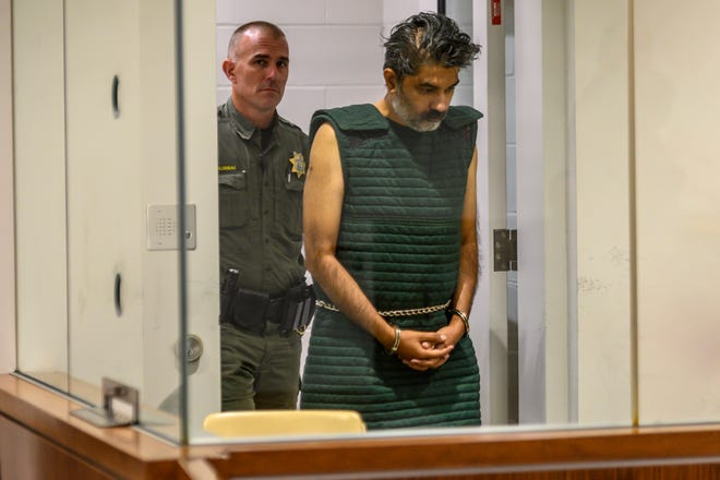 Shankar Hangud, wearing a personal safety vest, appears in the Placer County Superior Court Wednesday, Oct. 16, 2019, in Roseville, Calif.  Prosecutors say Hangud faces murder charges for allegedly killing four members of his family in Northern California. (Renee C. Byer/The Sacramento Bee via AP, Pool)