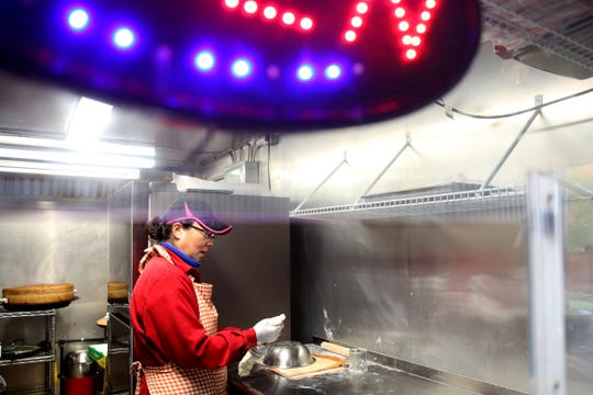 Lin Chen shapes dumplings at Shanghai's Best Street Food at The Yard Food Park in Salem on Oct. 18, 2019. Chen moved her business to Salem after her previous food truck pod in Portland was sold to developers.
