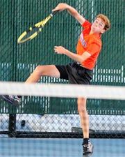 San Angelo Central High School's Richie Ramos hits an overhead during the District 3-6A championship against Abilene High at the Tut Bartzen Tennis Complex on Tuesday, Oct. 8, 2019.