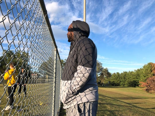 Lawrence Lightfoot watches the Staunton senior football team practice Thursday evening. Lightfoot, a volunteer coach with the youth football league, was dismissed as coach of the senior team this week.