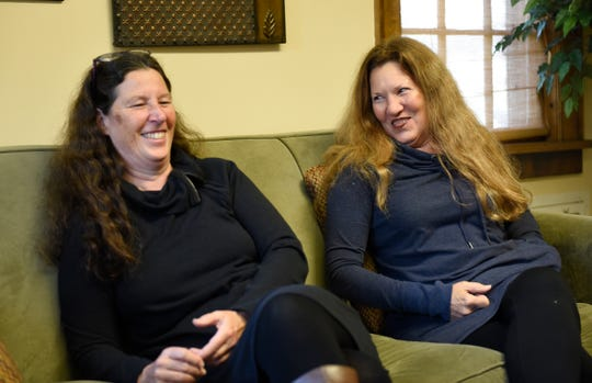 Lee LaDue, assistant director of the SCSU women's center, and Peggy LaDue, executive director at the Central Minnesota Sexual Assault Center, laugh during an interview Tuesday, Oct. 15, 2019, at the SCSU women's center.