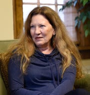 Peggy LaDue, executive director at the Central Minnesota Sexual Assault Center, sits during an interview Tuesday, Oct. 15, 2019, at the SCSU women's center.