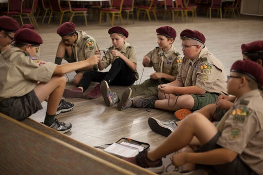 Scouts from Troop 0509 teach each other knots during one of their weekly meetings Monday, Oct. 7, 2019.