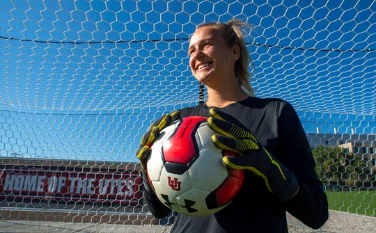 This Oct. 2, 2019 photo shows Carly Nelson, goalkeeper for the University of Utah women's soccer team in Salt Lake City. Nelson, who is openly gay, has faced a difficult journey on her path to acceptance that includes a suicide attempt as a teenager in Utah County, an evolving relationship with her family and recent health issues, all while thriving as a face of Ute soccer.  (Rick Egan/The Salt Lake Tribune via AP)