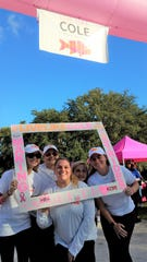 Family and friends of Cole Coppola celebrate with walkers at the Live Like Cole finish line at the Making Strides Against Breast Cancer walk on Oct. 12, 2019 at Riverside Park, Vero Beach.