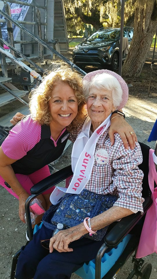 American Cancer Society Senior Manager Theresa Woodson, left, with 12-year survivor Ginny Martino at the 2019 Making Strides Against Breast Cancer walk at Riverside Park, Vero Beach.