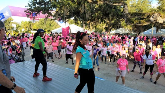 Making Strides Against Breast Cancer Committee member Vanessa Bartoszewicz leads the crowd in the pre-walk Zumba warm up on Oct. 12, 2019 at Riverside Park, Vero Beach.