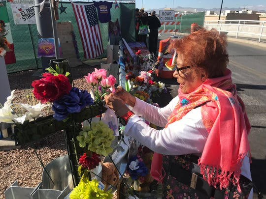 Gerarda Bezark made a cross that she tied to the memorial at the Eastside Walmart Friday.