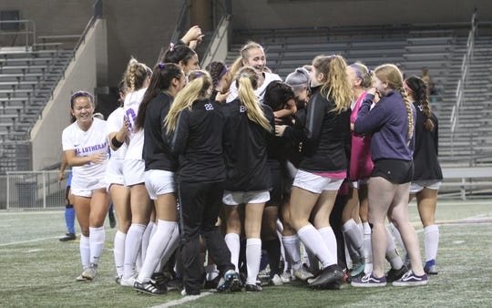 The Cal Lutheran University women's soccer team celebrates its 3-1 upset of national No. 7 Pomona-Pitzer 3-1 on Wednesday night at Rolland Stadium.