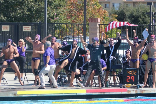 The Cal Lutheran University men's water polo team celebrates scoring a goal against Chapman on Oct. 12 at the Samuelson Aquatics Center in Thousand Oaks.