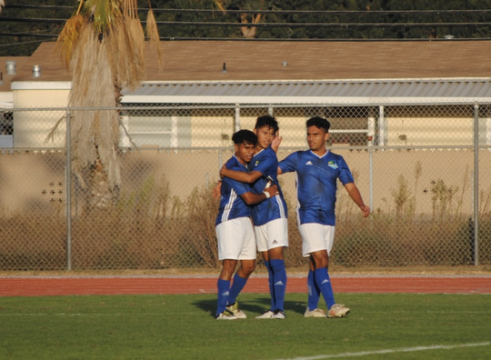 Members of the Oxnard College men's soccer team celebrate a goal against Moorpark on Tuesday at the Condors' Nest. OC handled Moorpark 5-0 in the WSC North opener for both teams.