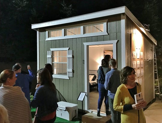 "People line up to check out a 250-square-foot tiny home at the Salt + Light launch party on Oct. 12, 2019. The Tulare nonprofit wants to build a ""micro-home community"" for the county's homeless."