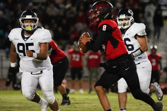 Redwood's Nathan Ibarra (95) chases down Hanford's Juaron Watts-Brown (8) during a West Yosemite League high school football game between Redwood (7-0) and Hanford (7-0) in Hanford Thursday night.