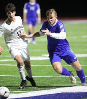 Pearl River's Brian Coughlan (14) and Clarkstown South's Charles Archul (17) battle for control of the ball during boys soccer game at Pearl River High School Oct. 17, 2019. Pearl River defeats Clarkstown South 6-2.