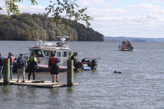 Yorktown Heights Fire Department divers are searching for a car that disappeared into the Hudson River in Verplank on Oct. 18, 2019.