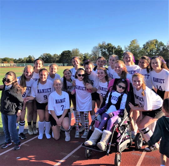 Members of the Nanuet field hockey team join with girls suffering from Rett Syndrome at their fundraising game vs. Clarksown North.