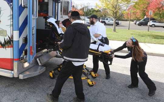 A child is placed in a Stony Point ambulance at Haverstraw Bay Park Oct. 18, 2019. Several children suffered from hypothermia after the boat they were on capsized in the Hudson River at Haverstraw Bay..