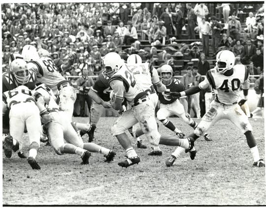 Wichita Falls quarterback Lawrence Williams (40) hands off to running back Joey Aboussie during the 1969 Class 4A state championship game in Waco. It remains the last of six state titles won by the Coyotes.