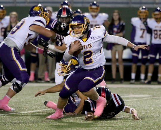 Abilene Wylie's Balin Valentine scrambles against Wichita Falls High Thursday, Oct. 17, 2019, at Memorial Stadium. The Bulldogs defeated the Coyotes 21-14 for their first win of the season.