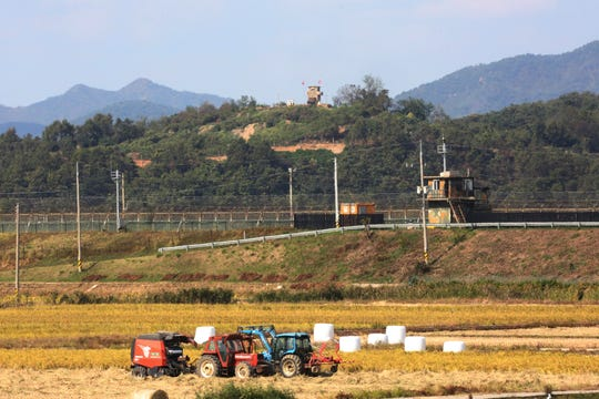Military guard posts of North Korea, top, and South Korea, center, are seen in Paju, South Korea, near the border with North Korea, Tuesday, Oct. 15, 2019. Amid swine fever scare that grips both Koreas, South Korea is deploying snipers, installing traps and flying drones along the rivals' tense border to kill wild boars that some experts say may have spread the animal disease from north to south.