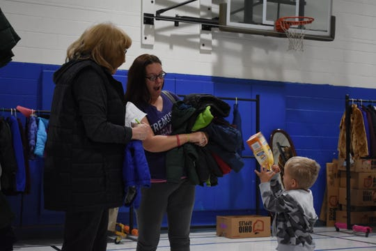 Patty Klamke, pictured left, a member of Women's Auxiliary, and Lindsay Vanmatre browsed for coats Friday for the six children in Lindsay's care.