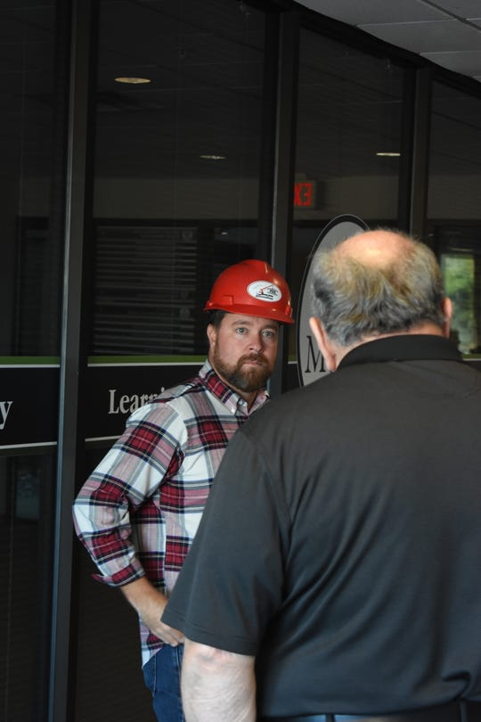 Phil Lash of Paul Construction discusses the implementation of new bathrooms at the health department with employees.