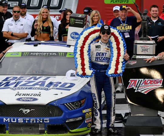 Ryan Blaney, right, celebrates after winning the 2019 playoff race at Talladega Superspeedway.