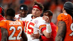 Patrick Mahomes is helped off the field after being injured against the Broncos.