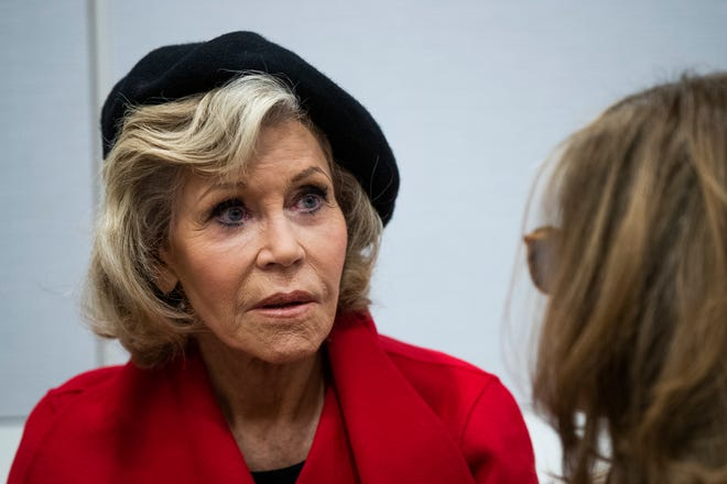 Jane Fonda talks to a fellow activist in Washington, D.C., on Oct. 18, 2019. A half-century after throwing her attention-getting celebrity status into Vietnam War protests, Fonda is now doing the same in other aspects of activism, including a U.S. climate movement where the average age is 18.