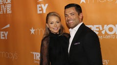 Actors Kelly Ripa and husband, Mark Consuelos, attend The Trevor Project's TrevorLIVE New York gala on Monday, June 17, 2019.