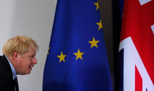 British Prime Minister Boris Johnson arrives for a media conference at an EU summit in Brussels, on Oct. 17, 2019.