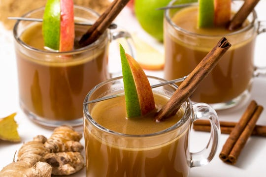 Hot apple cider with buttered rum.