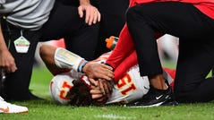 Patrick Mahomes lays on the turf following an injury in the second quarter against the Broncos.