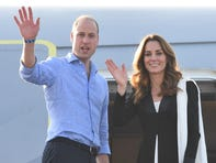 Prince William and Duchess Kate of Cambridge wave goodbye from their jet as they depart Islamabad, Pakistan after a five-day tour, on Oct. 18, 2019.