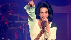 Prince performs on stage during his concert at the Parc des Princes stadium in Paris on June 16, 1990.