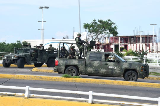 A handout photo made available by El Debate de Sinaloa shows clashes between armed groups and federal forces, in Culiacan, Mexico, October 17, 2019.