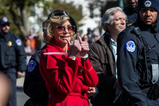 Jane Fonda gives two thumbs up following her arrest at a rally on Capitol Hill in Washington, on Oct. 18, 2019.