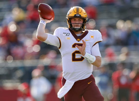 Oct 19, 2019; Piscataway, NJ, USA; Minnesota Golden Gophers quarterback Tanner Morgan (2) throws a pass against the Rutgers Scarlet Knights during the first half at SHI Stadium. Mandatory Credit: Noah K. Murray-USA TODAY Sports