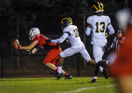 Blake Rezk of Wall, tries to make a catch in the end zone against Naron Alston of St. John Vianney in a game in Wall on Oct.18, 2019.
