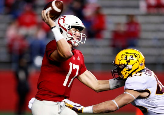 Oct 19, 2019; Piscataway, NJ, USA;  Rutgers Scarlet Knights quarterback Johnny Langan (17) throws an interception after being rushed by Minnesota Golden Gophers linebacker Carter Coughlin (45) during the second half at SHI Stadium. Mandatory Credit: Noah K. Murray-USA TODAY Sports
